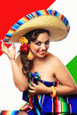 Happy cinco de mayo a smiling mexican pinup girl tipping her sombrero Royalty Free Stock Image