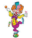 A happy clown standing on a ball and doing funny acrobatics Royalty Free Stock Photos
