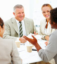 Happy colleagues having a business meeting Royalty Free Stock Photography