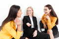 Happy colleagues women sitting in office talking with each other. Royalty Free Stock Photo
