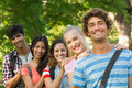Happy college friends standing in row at campus group portrait of a the Stock Photography