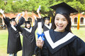 Happy college graduate holding a diploma with friends Royalty Free Stock Photo