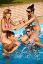 Happy companionship having fun at summer in pool Royalty Free Stock Photos