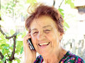 Happy comunnication old lady using mobile phone and have smile on her face Stock Photos