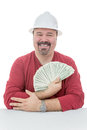 Happy construction worker holding dollar bills wearing a hard hat a large amount Royalty Free Stock Image