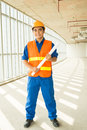 Happy constructor full length portrait of a young standing with a blueprint and smiling at camera Stock Photos