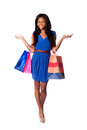 Happy consumerism shopping woman beautiful smiling walking fashion consumer with bags wearing pumps blue dress and belt on white Stock Photography