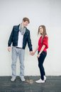 Happy cool teenage couple holding hands Royalty Free Stock Photography