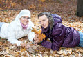 Happy couple in autumn leaves in the park Royalty Free Stock Photo