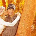 Happy couple in autumn park Stock Photos