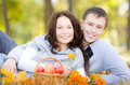 Happy couple in autumn park having picnic outdoors Royalty Free Stock Images