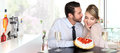 Happy couple at the bar with champagne and Strawberry cake, love Royalty Free Stock Photo