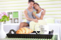 Happy couple in bed good morning with breakfast focus Royalty Free Stock Image