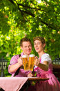Happy Couple in Beer garden drinking beer Stock Image