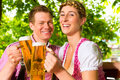 Happy Couple in Beer garden drinking beer Royalty Free Stock Photo
