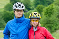 Happy couple in bike helmets Royalty Free Stock Photography