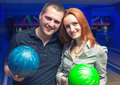 Happy couple in a bowling alley having fun Stock Photos