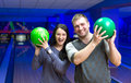 Happy couple in a bowling alley having fun Royalty Free Stock Image