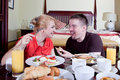 Happy couple at breakfast Royalty Free Stock Photos