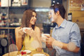 Happy couple in cafe two people enjoying the time spending with each other Royalty Free Stock Image