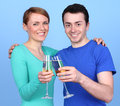 Happy couple a celebrating with champagne against a blue background Stock Photography