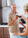 Happy couple celebrating with glass of wine Stock Photos
