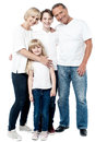 Happy couple with cheerful children smiling parents their standing together Stock Photo