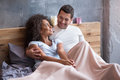 Happy couple chilling out in the bed together Royalty Free Stock Photo