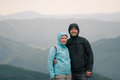 Happy couple at cold day on mountain trail Stock Photography