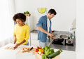Happy couple cooking food at home kitchen Royalty Free Stock Photo
