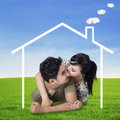 Happy couple with a dream house Royalty Free Stock Photo