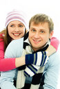 Happy couple dressed in winter clothes Stock Photo