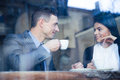 Happy couple drinking coffee in cafe Royalty Free Stock Photo