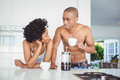 Happy couple drinking coffee in the kitchen Royalty Free Stock Photo