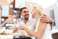 Happy couple drinking wine at open-air restaurant Royalty Free Stock Photo