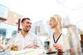 Happy couple eating dinner at restaurant terrace Royalty Free Stock Photo