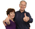 Happy couple an elderly showing a thumbs up sign isolated on white Stock Images