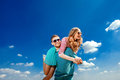 Happy couple embracing and having fun under the blue sky Stock Photo