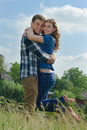 Happy couple embracing over blue sky background teenage boy and girl Royalty Free Stock Images