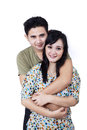 Happy couple embracing on white background beautiful young love smiling isolated Royalty Free Stock Photo
