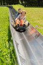 Happy couple enjoying alpine coaster luge portrait of during summer Stock Images