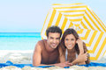 Happy Couple Enjoying At Beach Royalty Free Stock Photography