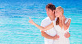 Happy couple enjoying beach young family in love spending honeymoon vacation on luxury islands cheerful active young people having Stock Photos
