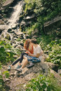 Happy couple enjoying beautiful nature near waterfall and looking on each other Stock Photography