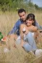 Happy couple enjoying countryside picnic Royalty Free Stock Images