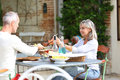 Happy couple enjoying lunch on terrace Royalty Free Stock Photo
