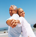 Happy couple enjoying their beach vacation Royalty Free Stock Photography