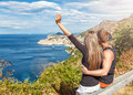 Happy couple enjoying the view of dubrovnik on their travels croatia Royalty Free Stock Photos