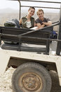 Happy couple in four wheel drive car in desert portrait of young stationary vehicle Royalty Free Stock Photography