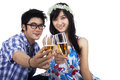 Happy couple with glasses of champagne young smiling cheerful attractive celebrating isolated Royalty Free Stock Photography